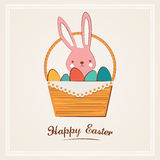Easter bunny with Easter basket full of Easter eggs Royalty Free Stock Photography