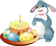Easter Bunny and Easter cake with candle. On white background Royalty Free Stock Photography
