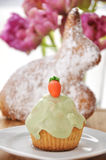 Easter Bunny with Easter Cupcake Stock Photography