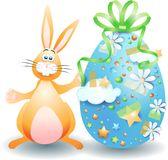 Easter bunny and Easter egg isolated on white Royalty Free Stock Photo