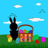 Easter Bunny and Easter eggs in the basket, Easter greeting card Stock Photo