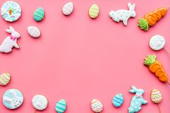 Easter bunny and easter eggs cookies. Easter symbols and traditions. Pink background top view copy space. Easter bunny and easter eggs cookies. Easter symbols Stock Photography