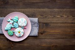 Easter bunny and easter eggs cookies. Sweets, pastry for Easter table. Dark wooden background top view copy space. Easter bunny and easter eggs cookies. Sweets Stock Image