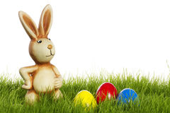 Easter bunny with easter eggs in grass Stock Photos