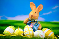 Easter bunny with Easter eggs. In green gras Stock Image