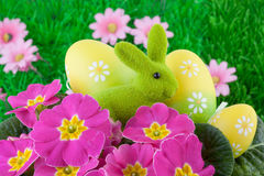 Easter Bunny with Easter Eggs on Green Grass Stock Image