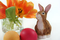 Easter bunny with Easter eggs and tulips Royalty Free Stock Images