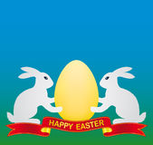 Easter bunny and egg Stock Photos