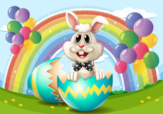 Easter bunny with egg and balloons. Illustration Stock Images