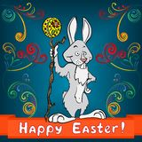 Easter bunny with egg and cane Stock Photo