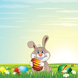Easter Bunny Egg Hunt on Green Meadow Royalty Free Stock Photography