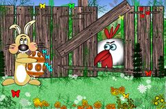 Easter bunny with egg near a wooden fence in the meadow. Rooster sitting about a fence Royalty Free Stock Images