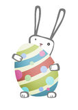 Easter Bunny with egg. Easter rabbit hiding behind a large egg Royalty Free Stock Image