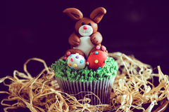 Easter bunny with eggs. Easter bunny with colorful eggs on cup cake,selective focus Stock Images