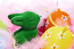 Easter bunny and eggs and feathers Stock Photos