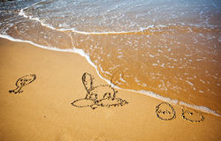 Easter bunny and eggs drawn in sand Royalty Free Stock Photography