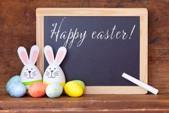 Easter bunny eggs with ears and chalkboard royalty free stock photos