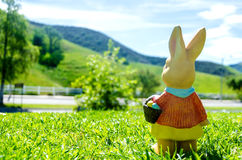 Easter bunny with eggs in field Royalty Free Stock Photo