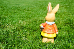 Easter bunny with eggs in field Royalty Free Stock Photography
