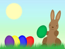 Easter Bunny with Eggs on grassland Stock Photos
