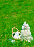 Easter bunny and eggs on green grass. Easter bunny and Easter eggs on green grass royalty free stock photos