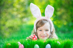 Easter bunny and eggs on green grass Stock Photo