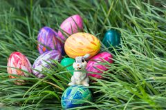 Easter bunny and eggs on  the green grass. Easter bunnies and eggs hiding in between the green grass Stock Photo