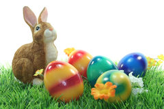 Easter bunny with eggs on a lawn Royalty Free Stock Image