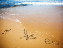 Easter bunny and eggs in sand on tropical beach Royalty Free Stock Photography