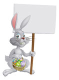 Easter bunny with eggs and sign Stock Photos