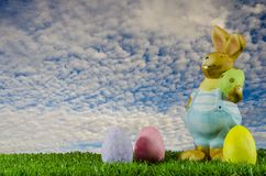 Easter bunny and eggs in the aky stock image