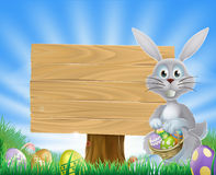 Easter bunny eggs and wooden sign Royalty Free Stock Images