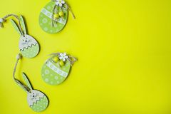Easter Bunny and Easter eggs on a yellow background. View from above. Copy space, space for text stock images
