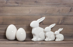 Easter bunny family and white ceramic eggs Stock Photo