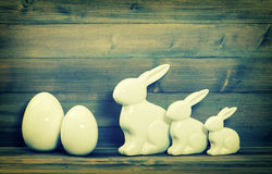 Easter bunny family and white ceramic eggs. Vintage easter decor Royalty Free Stock Image