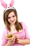 Easter bunny female with easter eggs in her hand Stock Photography