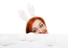 Easter bunny female looking over table for easter eggs Stock Images