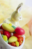 Easter bunny figure with sugar easter eggs Stock Photography