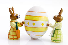 Easter bunny figures with painted easter egg Royalty Free Stock Photography