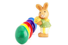 Easter bunny figurine in front of deep row of east Royalty Free Stock Images