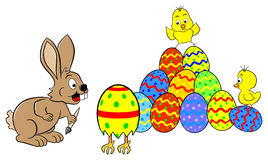 Easter bunny finds a running easter egg Royalty Free Stock Image