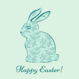 Easter bunny with a flower pattern on a light blue background wi. Th polka dots Royalty Free Stock Image