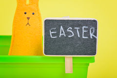 Easter Bunny in flower pot with blackboard Stock Image