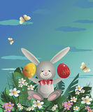 Easter bunny 12. At flowering lawn under blue sky Easter bunny sitting and holding in the paws painted Easter eggs. Vector illustration Stock Image