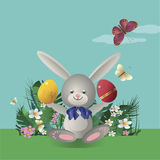 Easter bunny 10. At flowering lawn under blue sky Easter bunny sitting and holding in the paws painted Easter eggs. Vector illustration Stock Images