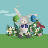 Easter bunny 5. At flowering lawn under the blue sky, the Easter Bunny walks and holds in paws painted Easter eggs. Vector illustration Stock Photos