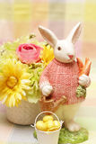 Easter bunny flowers and eggs. Easter bunny, flowersin the vase and eggs Stock Photography