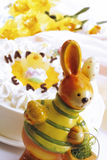 Easter bunny in front of Easter cake Royalty Free Stock Photos