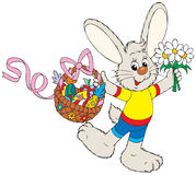 Easter Bunny with the fruits basket and flowers Stock Photo