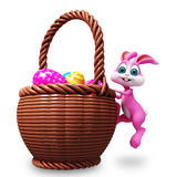 Easter bunny with full age bucket Royalty Free Stock Image